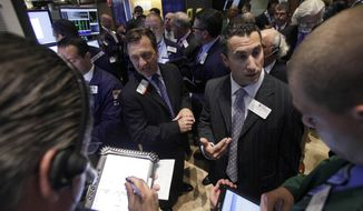 Traders gather July 26, 2012, at a post on the floor of the New York Stock Exchange during the IPO of Northern Tier Energy. U.S. stocks soared at the opening bell after the president of the European Central Bank vowed to do what it takes to preserve the continent's monetary union. (Associated Press)
