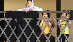 Syrian refugees arrive July 26, 2012, at the border crossing by the Iraqi town of Qaim, 200 miles (320 kilometers) west of Baghdad. (Associated Press)