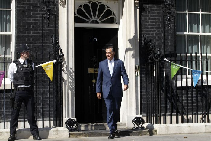 Republican presidential candidate Mitt Romney walks out of 10 Downing Street in London after meeting with British Prime Minister David Cameron on Thursday, July 26, 2012. (Associated Press)