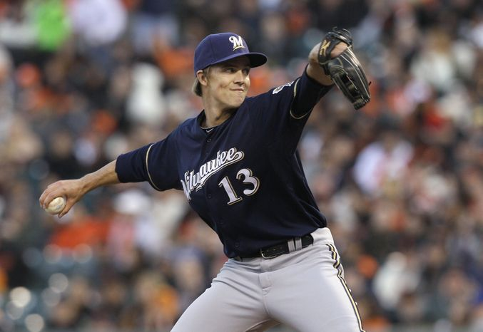 In this May 4, 2012, photo, Milwaukee Brewers pitcher Zack Greinke throws to a San Francisco Giants batter in a baseball game in San Francisco. Greinke has been traded by the Brewers to the Los Angeles Angels for rookie shortstop Jean Segura and two minor league