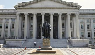 **FILE** A statue of former Treasury Secretary Albert Gallatin stands outside the Treasury Building in Washington on Aug. 8, 2011. (Associated Press)