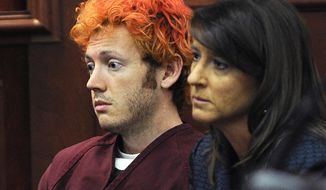 ** FILE ** James Holmes, accused of killing 12 people in a July 20 shooting rampage at an Aurora, Colo., movie theater, appears on Monday, July 23, 2012, in Arapahoe County District Court in Centennial, Colo., with defense attorney Tamara Brady. (Associated Press/Denver Post)