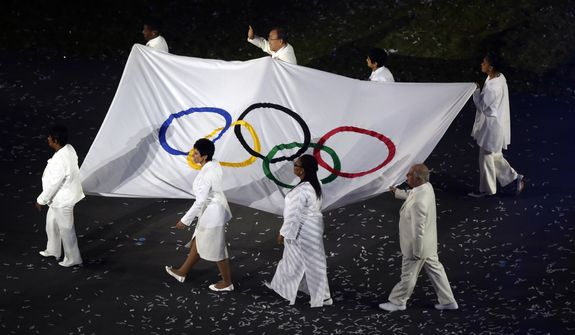 The OIympic flag is carried around the stadium during the Opening Ceremony at the 2012 Summer Olympics, Friday, July 27, 2012, in London. (AP Photo/Charlie Riedel)