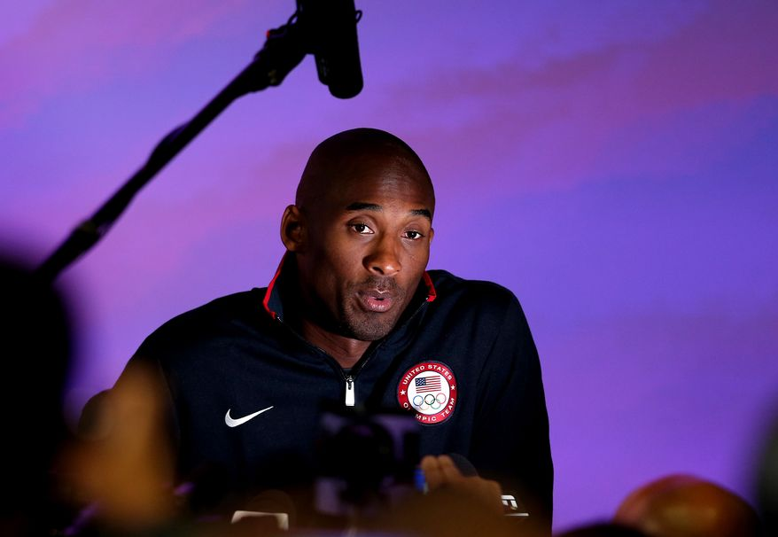 United States basketball player Kobe Bryant speaks to reporters during a news conference at the Olympic Park, Friday, July 27, 2012, in London. The 2012 Summer Olympics begin with opening ceremonies on Friday. (AP Photo/Stephen Pond, PA)