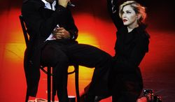 In this photo provided by Guy Oseary, Madonna performs July 26, 2012, onstage during her MDNA concert at Olympia Hall in Paris. (Associated Press)
