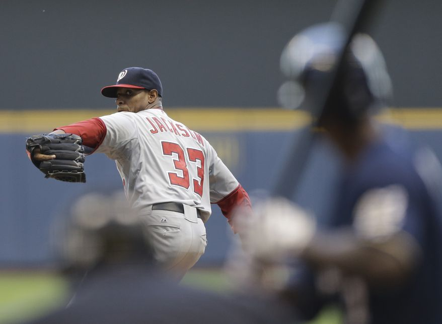 Washington Nationals starting pitcher Edwin Jackson throws to a Milwaukee Brewers batter during the first inning of a baseball game Thursday, July 26, 2012, in Milwaukee. (AP Photo/Jeffrey Phelps)