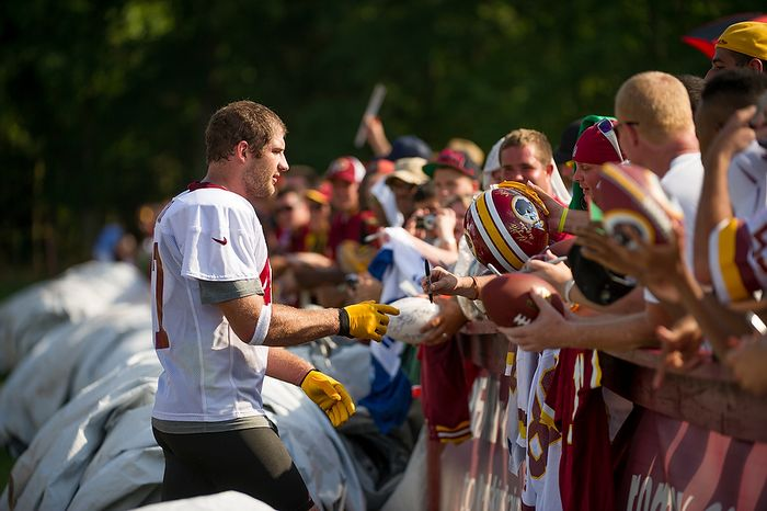 Washington Redskins tight end Chris Cooley (47) signs autographs for fans following afternoon practice on the first day of training camp at Redskins Park, Ashburn, Va., Thursday, July 26, 2012. (Andrew Harnik/The Washington Times)