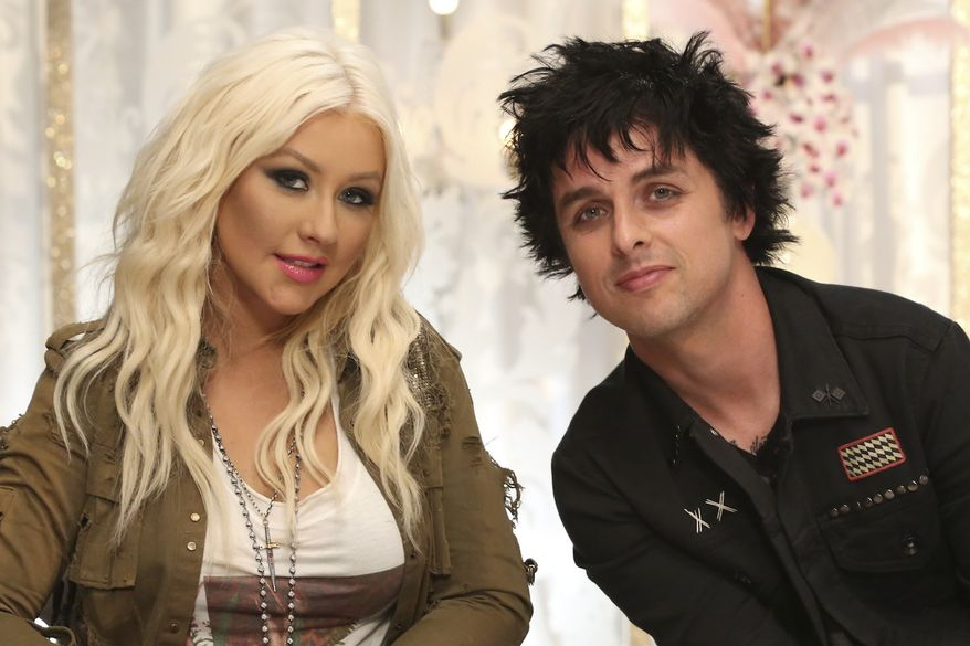 """**FILE** Billie Joe Armstrong (right) sits July 25, 2012, with Christina Aguilera. Armstrong will join Aguilera as her team's mentor this season on NBC's """"The Voice."""" (Associated Press/NBCUniversal)"""