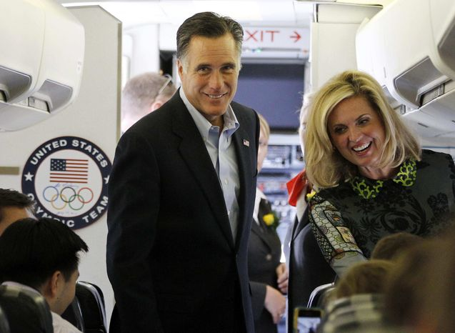 Republican presidential candidate Mitt Romney and his wife, Ann, board a charter plane at London Stansted Airport on Saturday, July 28, 2012, as they travel to Israel. (AP Photo/Charles Dharapak)
