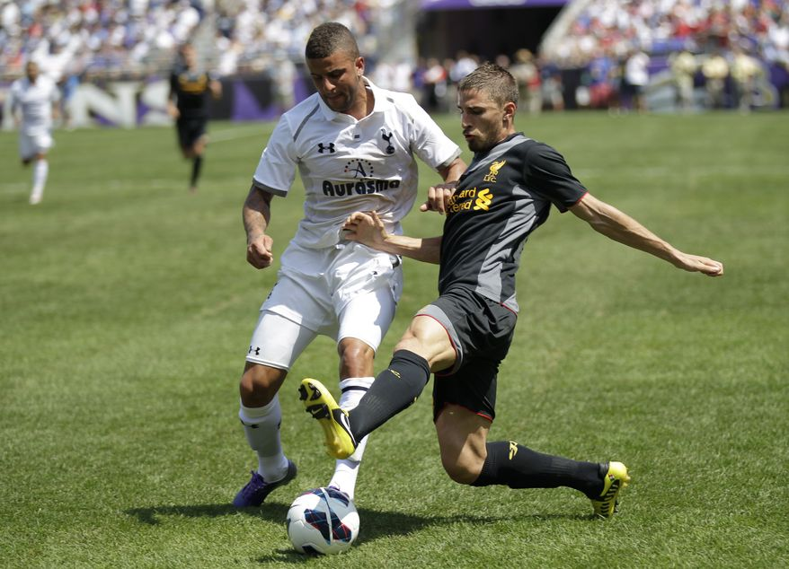 Tottenham Hotspur's Kyle Walker, left, and Liverpool FC's Fabio Borini, right, battle for the ball during the second half of a friendly soccer match at M&T Bank Stadium in Baltimore, Saturday, July 28, 2012. The game ended in a scoreless tie. (AP Photo/Luis M. Alvarez)