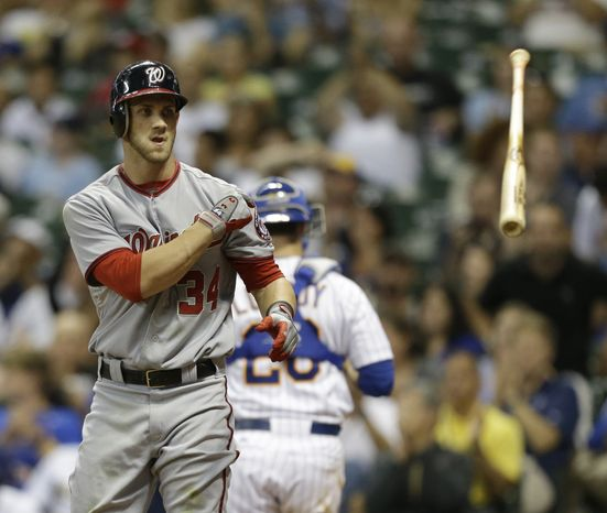 Washington Nationals' Bryce Harper tosses his bat after striking out against the Milwaukee Brewers during the eighth inning of a baseball game, Friday, July 27, 2012, in Milwaukee. (AP Photo/Jeffrey Phelps)