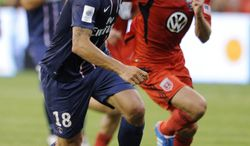 Paris Saint-Germain forward Zlatan Ibrahimovic (18) moves the ball upfield against D.C. United during the first half of an international friendly soccer game in the World Football Challenge, Saturday, July 28, 2012, in Washington. (AP Photo/Nick Wass)