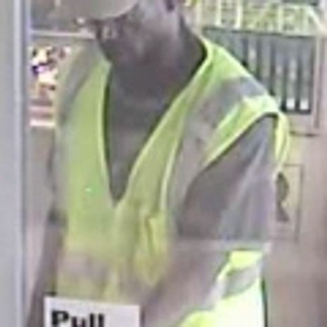 The suspect in the murder and robbery at a Columbia Pike jewelry store appears in a frame from the store's security camera. Photo from Arlington County police.