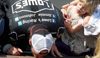 associated press  Jimmie Johnson kisses the yard of bricks after winning the Sprint Cup Series race at Indianapolis Motor Speedway as daughter Genevieve Marie, 2, looks on. Johnson also won at the Brickyard in 2006, 2008 and 2009.
