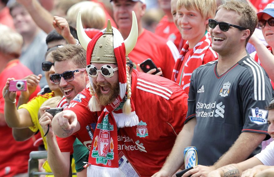 Liverpool fans cheered their team, but neither Liverpool FC nor Tottenham Hotspur could find the net as they played to a scoreless draw Saturday at M&T Bank Stadium. The afternoon match drew 42,723 despite temperature in the mid-90s. (Associated Press)
