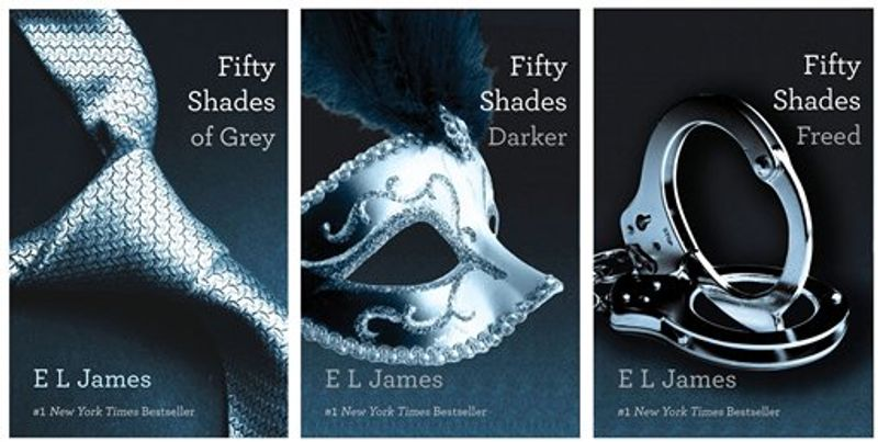 """** FILE ** This combo made of book cover images provided by Vintage Books shows the """"Fifty Shades of Grey"""" trilogy by best-selling author E L James. (AP Photo/Vintage Books, File)"""
