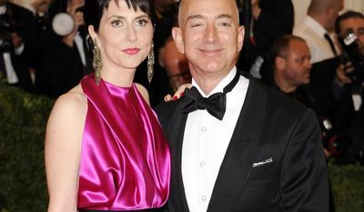 **FILE** Amazon.com founder and CEO Jeff Bezos and his wife, MacKenzie, arrive May 7, 2012, at the Metropolitan Museum of Art Costume Institute in New York for a gala benefit celebrating Elsa Schiaparelli and Miuccia Prada. (Associated Press)