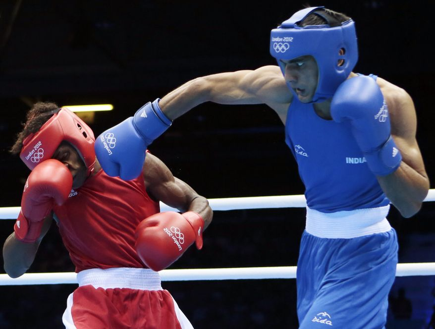 India's Bhagwan Jai, right, connects with Andrique Allisop of the Seychelles, during men's light 60-kg boxing at the 2012 Summer Olympics, Sunday, July 29, 2012, in London. (AP Photo/Ivan Sekretarev)