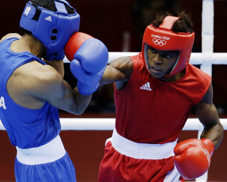 Andrique Allisop of the Seychelles, right, connects with India's Bhagwan Jai, during men's light 60-kg boxing at the 2012 Summer Olympics, Sunday, July 29, 2012, in London.  (AP Photo/Patrick Semansky)