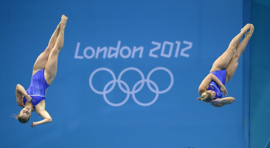 Abigail Johnston and Kelci Bryant of the USA compete during the 3 Meter Synchronized Springboard final at the Aquatics Centre in the Olympic Park during the 2012 Summer Olympics in London, Sunday, July 29, 2012. USA won the silver medal in the event. (AP Photo/Mark J. Terrill)