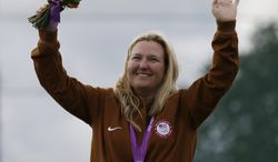 United States of America's Kimberley Rhode celebrates after winning the gold medal in the women's skeet, at the 2012 Summer Olympics, Sunday, July 29, 2012, in London. (AP Photo/Rebecca Blackwell)