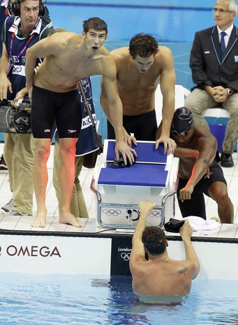 The United States men's swimming relay team from left, Michael Phelps, Nathan Adrian, Cullen Jones, and Ryan Lochte react to their silver medal win in the men's 4x100-meter freestyle relay final men's relay at the Aquatics Centre in the Olympic Park during the 2012 Summer Olympics in London, Sunday, July 29, 2012.(AP Photo/Lee Jin-man)