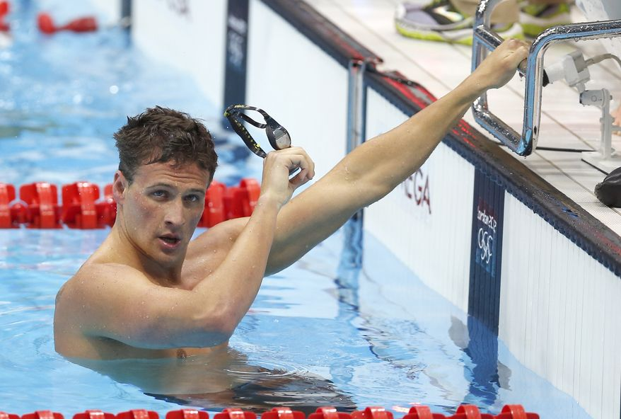 United States' Ryan Lochte reacts after his relay team's silver medal win in the men's 4x100-meter freestyle relay final men's relay at the Aquatics Centre in the Olympic Park during the 2012 Summer Olympics in London, Sunday, July 29, 2012. (AP Photo/Daniel Ochoa De Olza)