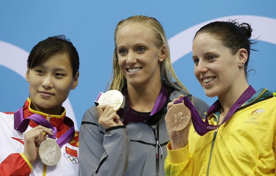 From left, China's Lu Ying, United States' Dana Vollmer, and Australia's Alicia Coutts pose with their medals for the women's 100-meter butterfly swimming final at the Aquatics Centre in the Olympic Park during the 2012 Summer Olympics in London, Sunday, July 29, 2012. Vollmer won gold, Lu silver and Coutts bronze. (AP Photo/Michael Sohn)