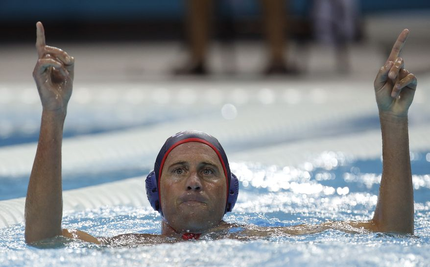 Adam Wright of the United States reacts after scoring against Montenegro in a preliminary water polo match at the 2012 Summer Olympics, Sunday, July 29, 2012, in London. The U.S. won 8-7. (AP Photo/Julio Cortez)