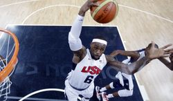 Team USA forward Lebron James (6) grabs a rebound during the first half of the United States' 98-71 win against France on July 29, 2012, at the 2012 Summer Olympics in London. (Associated Press)