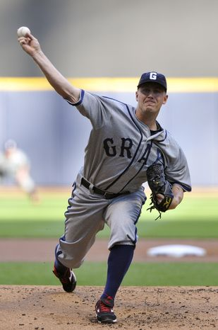 Washington Nationals' Jordan Zimmermann pitches against the Milwaukee Brewers during the first inning of a basebal