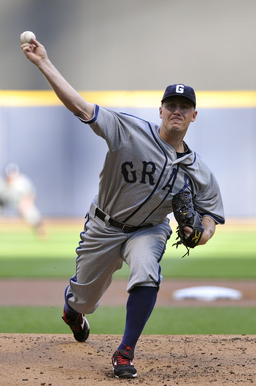 Washington Nationals' Jordan Zimmermann pitches against the Milwaukee Brewers during the first inning of a baseball game Saturday, July 28, 2012, in Milwaukee. (AP Photo/Jim Prisching)