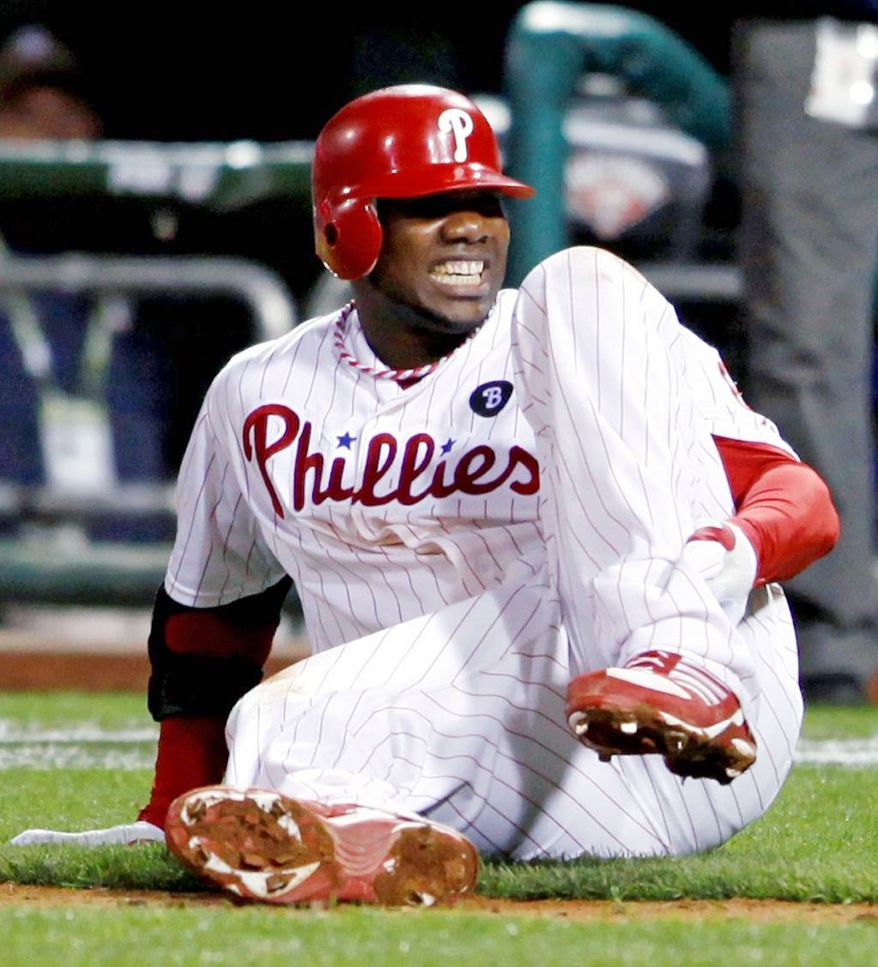 FILE - In this Oct. 7, 2011, file photo, Philadelphia Phillies' Ryan Howard reacts after falling down injured on his way to first base as he makes the last out during the ninth inning of Game 5 of the National League division baseball series against the St. Louis Cardinals, in Philadelphia. (AP Photo/Alex Brandon, File)