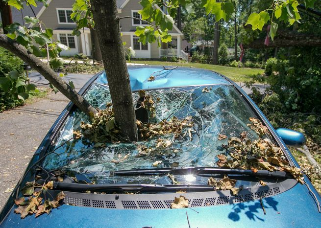 A branch remains impaled in a car in Bethesda three days after the June 29 derecho. More thunderstorms since then have brought down even more trees. (Andrew S. Geraci/The Washington Times)