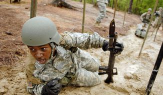 A U.S. Army recruit negotiates the confidence course during the white phase of basic combat training at Fort Jackson, S.C., on June 14, 2006. The training lasts nine weeks and is divided into red, white and blue phases. Soldiers in the white phase are in their final three weeks. (Department of Defense/Staff Sgt. Stacy L. Pearsall, U.S. Air Force)