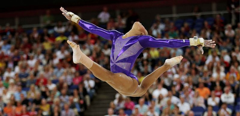 U.S. gymnast Gabrielle Douglas of Virginia Beach performs her floor routine during qualifying Sunday at the Summer Olympics. She will compete in the team finals Tuesday and all-around finals Thursday. (Associated Press)