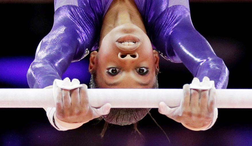 Though homesick, gymnast Gabrielle Douglas of Virginia Beach credits years of training in Iowa for paving her way to the London Olympic Games. (Associated Press)