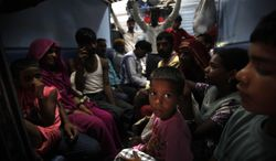 Passengers sit in a train and wait for power to get restored July 30, 2012, at a railway station in New Delhi. A major power outage struck northern India, plunging cities into darkness and stranding hundreds of thousands of commuters. (Associated Press)