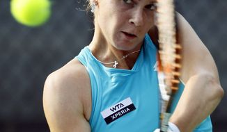 Magdalena Rybarikova, of Slovakia, returns a shot during a match against Chanelle Scheepers, of South Africa, at the City Open tennis tournament, Monday, July 30, 2012, in Washington. Rybarikova won 6-2, 6-1. (AP Photo/Carolyn Kaster)