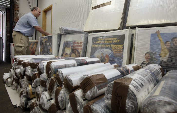 Ira Kramer, nephew of the original Movie Star News founder Irving Klaw, looks over movie posters packed for transport, at the shop in New York on July 25, 2012. Movie Star News, a New York institution since 1939 credited with creating the concept of pin-up art, has been shuttered, and with it nearly 3-mill