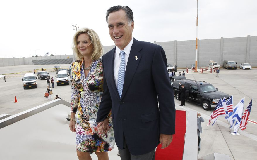 Republican presidential candidate Mitt Romney and his wife, Ann, board their charter plane in Tel Aviv on July 30, 2012, as they prepare to travel to Poland. (Associated Press)