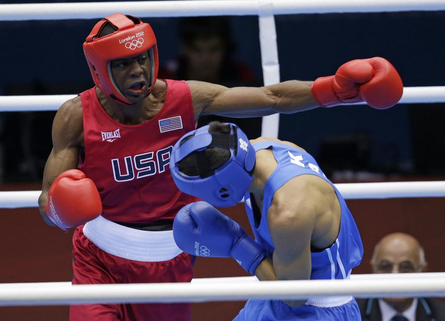 United States' Jamel Herring, left, fights Kazakhstan's Daniyar Yeleussinov during a light welterweight 64-kg preliminary boxing match at the 2012 Summer Olympics, Tuesday, July 31, 2012, in London. (AP Photo/Patrick Semansky)