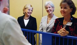 **FILE** North Carolina Gov. Bev Perdue (left) and Health and Human Services Secretary Kathleen Sebelius watch a pediatric primary care scenario before Sebelius announced that Duke Hospital would be one of five hospitals selected to participate in a new initiative to train more advanced practice registered nurses on July 30, 2012, at Duke University School of Nursing in Durham, N.C. (Associated Press/The Herald-Sun)