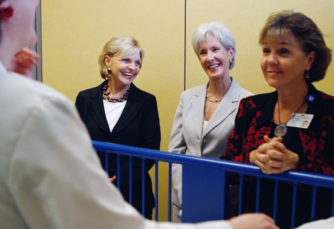 **FILE** North Carolina Gov. Bev Perdue (left) and Health and Human Services Secretary Kathleen Sebelius watch a pediatric primary care scenario before Sebelius announced that Duke Hospital would be one of five hospitals selected to participate in a new initiative to train more advanced practice registered nurses on July 30, 2012, at Duke University School of Nursing in Durham
