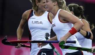 The United States' Shannon Taylor, center, is congratulated by teammates after scoring the lone goal against Argentina during their women's hockey preliminary match at the 2012 Summer Olympics, Tuesday, July 31, 2012, in London. The U.S. won 1-0. (AP Photo/Bullit Marquez)