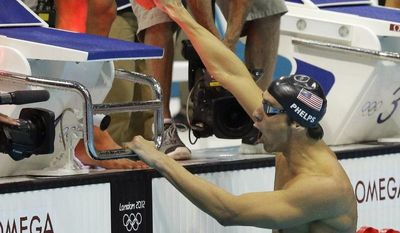 United States' Ricky Berens, left, and United States' Michael Phelps react as they win gold in the men's 4x200-meter freestyle relay swimming final at the Aquatics Centre in the Olympic Park during the 2012 Summer Olympics in London, Tuesday, July 31, 2012. (AP Photo/Matt Slocum)