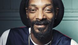Snoop Dogg, who now goes by Snoop Lion, poses for a portrait at Miss Lily's in New York on July 30, 2012. (Victoria Will/Invision/Associated Press)
