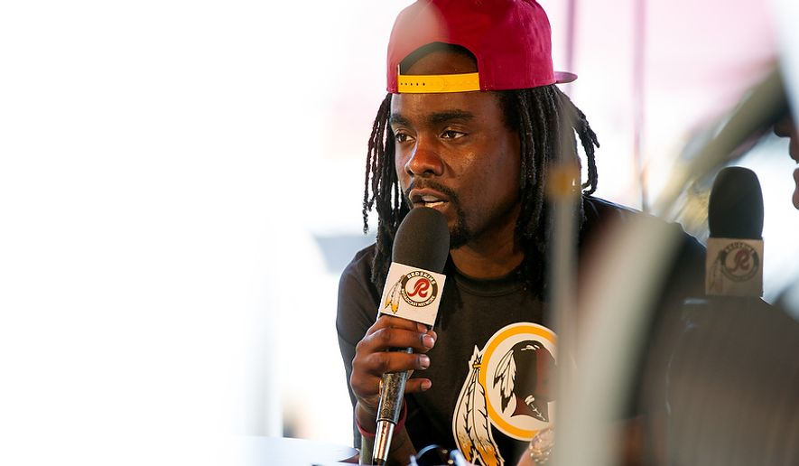 Rapper Wale speaks on a Redskins program during afternoon practice at the Washington Redskins training camp at Redskins Park, Ashburn, Va., Washington, D.C., Monday, July 30, 2012. (Andrew Harnik/The Washington Times)