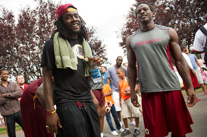 Rapper Wale, left, and Washington Redskins wide receiver Anthony Armstrong (13), right, speak together following afternoon practice at the Washington Redskins training camp at Redskins Park, Ashburn, Va., Washington, D.C., Monday, July 30, 2012. (Andrew Harnik/The Washington Times)