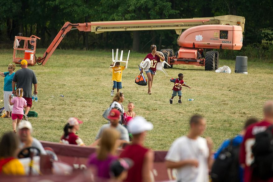 Fans pack up and leave following afternoon practice at the Washington Redskins training camp at Redskins Park, Ashburn, Va., Washington, D.C., Monday, July 30, 2012. (Andrew Harnik/The Washington Times)